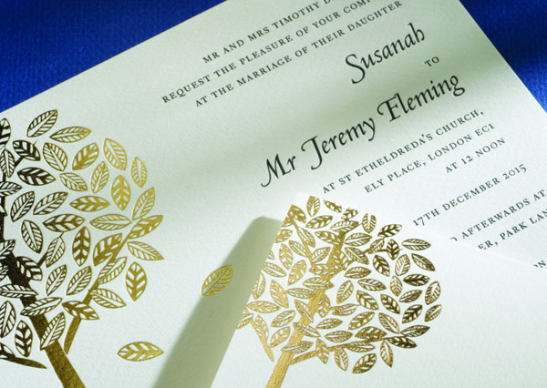 Marriage invite with letterpress text and gold foiled graphics